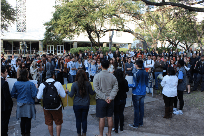 Protesters listen to speakers from different cultural UT organizations give talks before marching to Fiji fraternity house. (Cassandra Jaramillo)