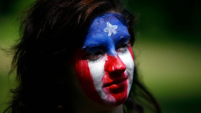 Puerto Rican flag-painted face at Occupy Puerto Rico protest in San Juan (Dave Lobby/Flickr)