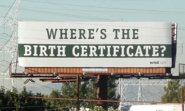 A billboard asking President Obama to publish his birth certificate (Credit: Victor Victoria/Flickr)