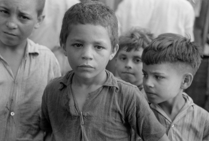 Children who were begging for pennies in the market in Rio Piedras, Puerto Rico, 1942 (C. Thomas Anderson/Flickr)