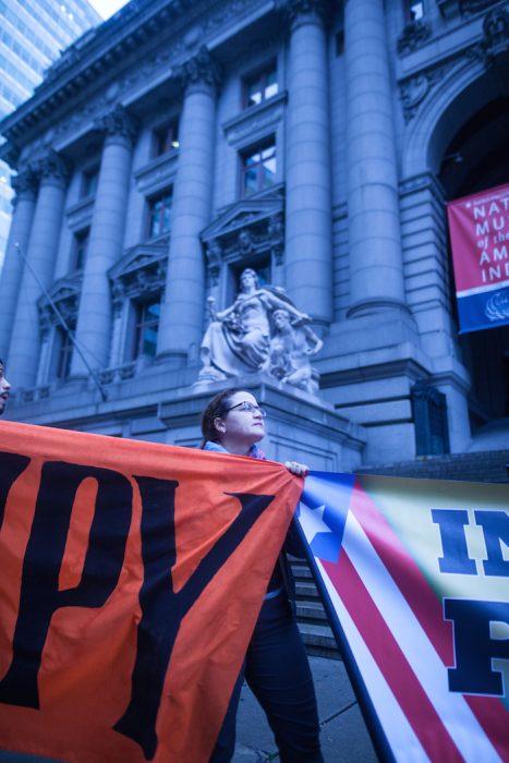 Protester outside of the Alexander Hamilton U.S. Custom House