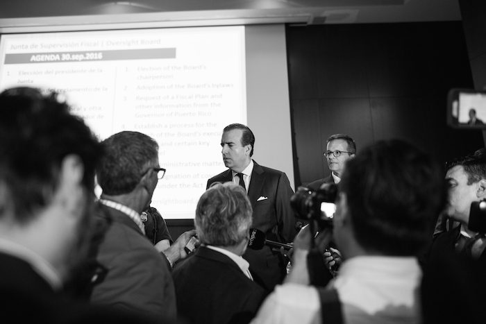 Jose Carrión III, chairman of the board, answers questions for press after the meeting.