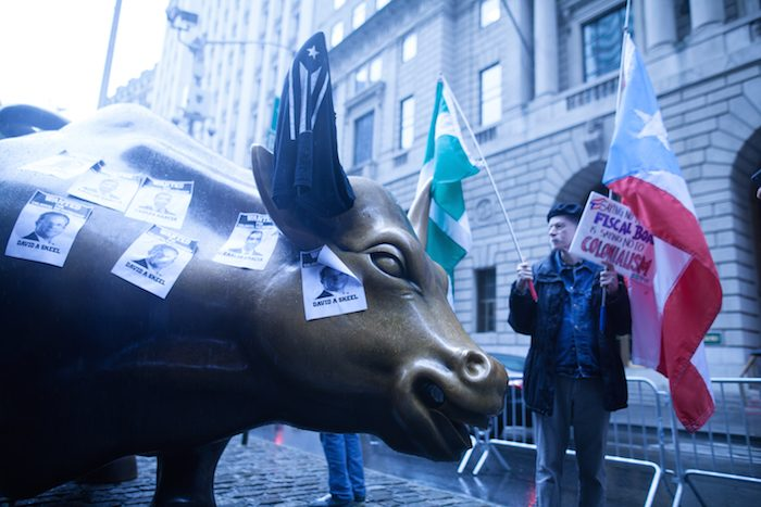Protesters and police at the Wall Street Bull after the meeting.