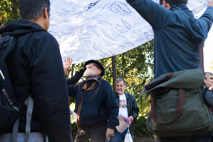 Puerto Rican artist Antonio Martorell reads through messages for Oscar Lopez Rivera written on a blanket.