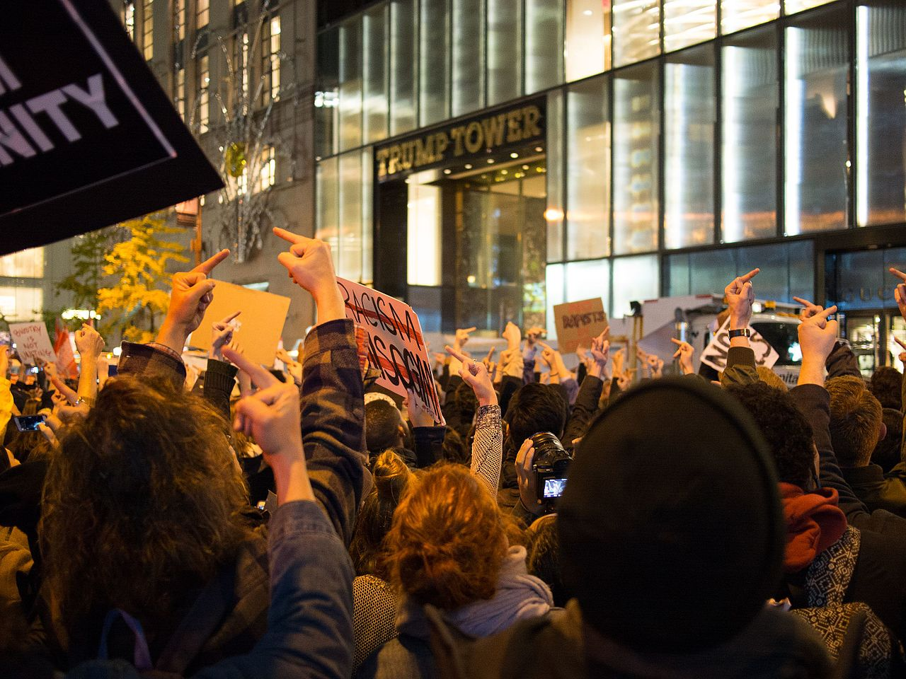 Protesters in Manhattan flip their middle fingers against the presidency of Donald Trump on November 9, 2016. (Photo by Rhododendrites/Wikimedia Commons)